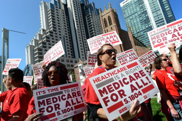 Sandra Falwell, right, and fellow nurses rally to hear Senator Bernie Saunders speak at the annual convention of the California Nurses Association at Yerba Buena Gardens in San Francisco, Calif., on Friday, Sept. 22, 2017. Saunders, who introduced a single-payer health care legislation, is trying to bring more attention to and gather support for his bill. (Dan Honda/Bay Area News Group)