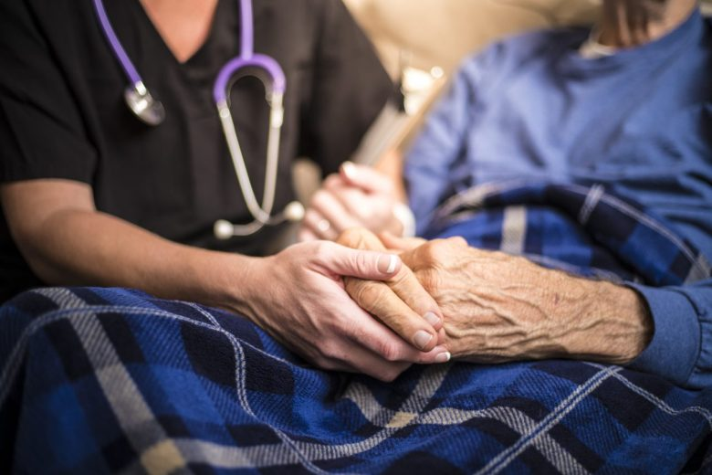 photo of Hospice Nurse visiting an elderly male patient