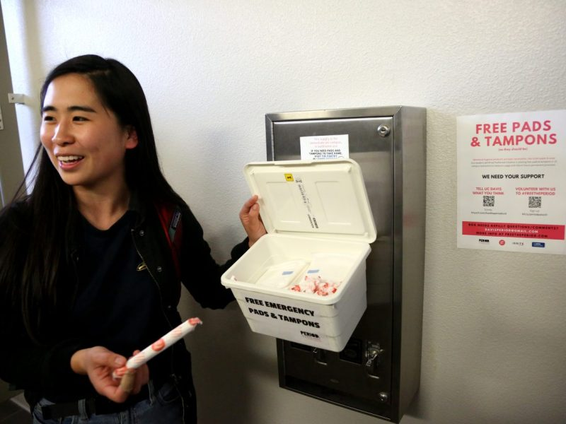 UC Davis students Annie Wang is working to ensure placement of tampons and pads in UC Davis restrooms as part of a program now supported by volunteers, donations and the university. Photo by Maria Avila for CALmatters
