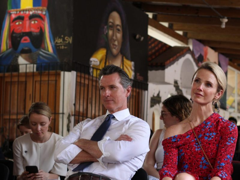 California Gov. Gavin Newsom wife Jennifer Siebel Newsom listen to a recital of violins by young Salvadorans who belong to a music academy in Panchimalco, El Salvador, AP Photo by Salvador Melendez/Pool