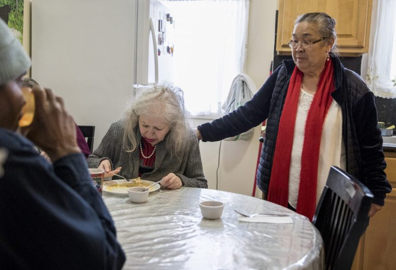 Carmen Palarca checks in on resident Sandy Pemberton as she eats lunch at Palarca's Rest Home in San Francisco. Photos by Jessica Christian, San Francisco Chronicle