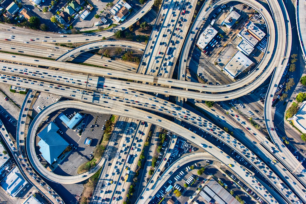 An aerial shot of a busy Los Angeles freeway interchange.