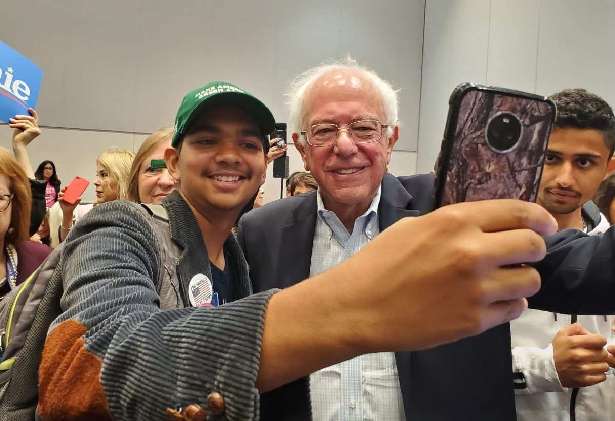 Delegates at the California Democratic Convention in San Francisco snap selfies with Vermont Sen. Bernie Sanders, who's once again seeking the party's nomination for president. Photo by Elizabeth Castillo for CALmatters