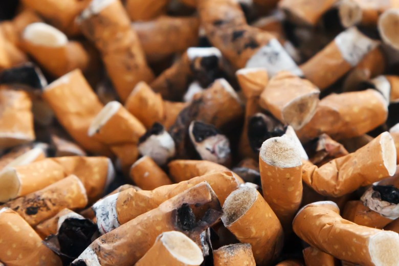 A photo of cigarette butts in a pile.