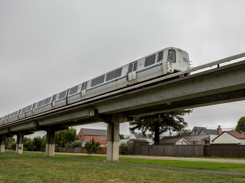 A BART train runs through a neighborhood of single-family homes in Albany. California lawmakers again rejected a bill that would have led to denser development along public transit routes. Photo by Anne Wernikoff for CalMatters