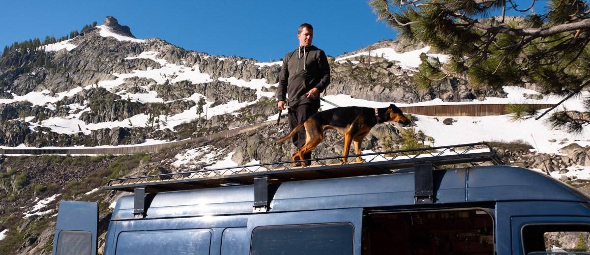 Van liver Travis Wild eats breakfast with his dog, Ayla.