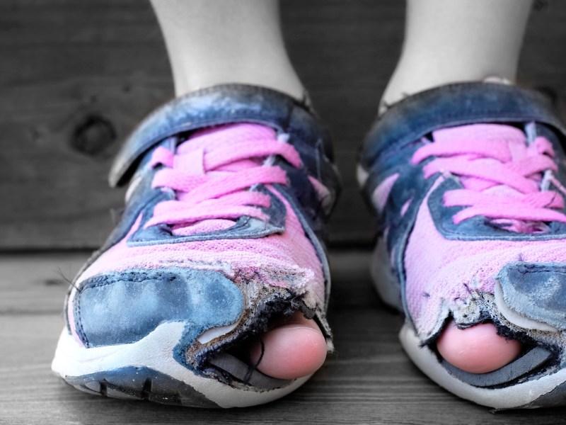 A pair of worn out tennis shoes illustrate an all-too-common symptom of income inequality: child poverty. More than 27 percent of children in Santa Cruz county are in poverty, the second highest rate in California