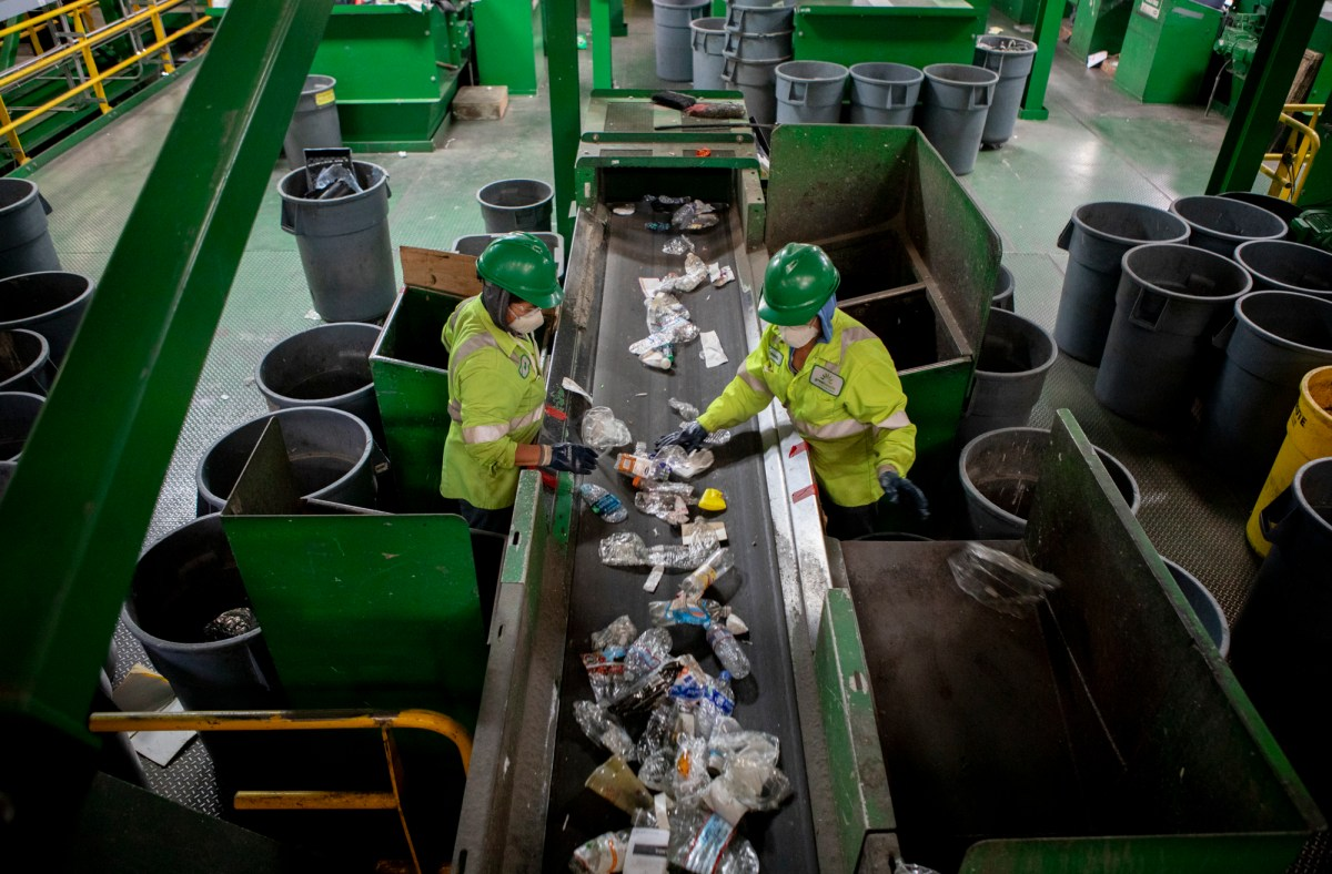 Workers at GreenWaste Recovery sort plastic waste.