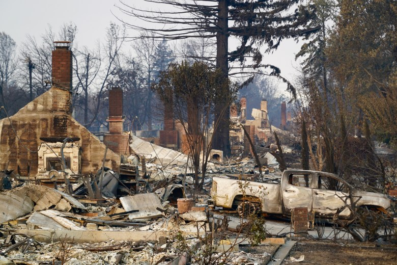 Burned homes, trees and vehicles in the Northern California city of Santa Rosa, after a devastating 2017 wildfire. Photo by Anne Belden, istockphotos.com