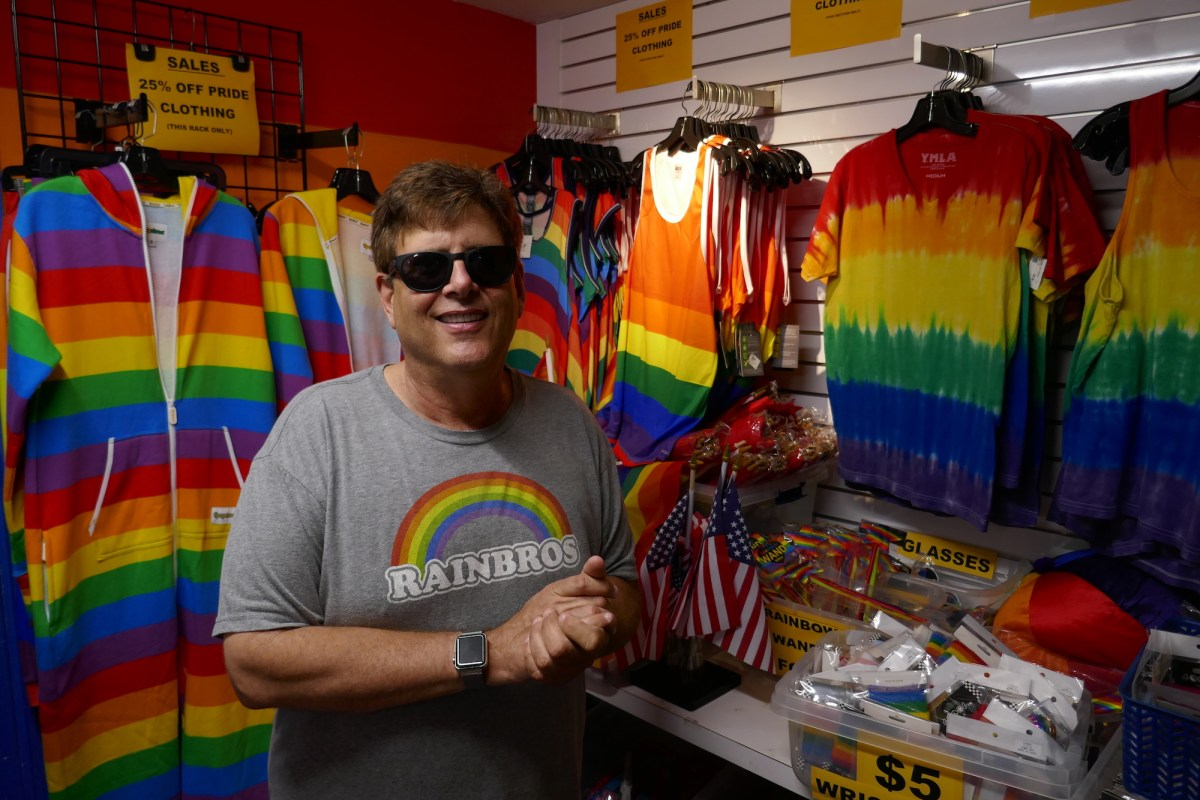 Larry Block owns Block Party, one of a handful of gay-owned and gay-centric shops left on Santa Monica Blvd. in West Hollywood. He's lived in WeHo since 1985, but worries the neighborhood is going too mainstream. Photo by Elizabeth Aguilera for CalMatters
