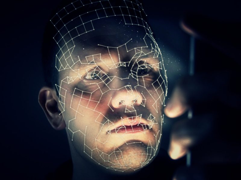 A man'Data measurements pinpoint a man's face. California lawmakers may prevent police agencies from using facial recognition technology — at least for now. Photo via iStock