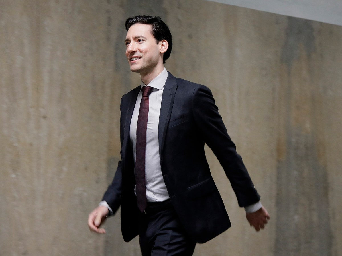 David Daleiden walks outside of a courtroom in San Francisco, Monday, Feb. 11, 2019. Planned Parenthood has made an unusual legal demand to join California's criminal prosecution of two anti-abortion activists charged with invasion of privacy for secretly making videos as they tried to buy fetal material from the organization.(AP Photo/Jeff Chiu)