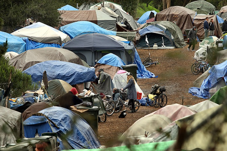 Homeless encampments like this one in Santa Cruz contribute to rising public concern about homelessness and housing in California. Photo by Dan Coyro/Santa Cruz Sentinel