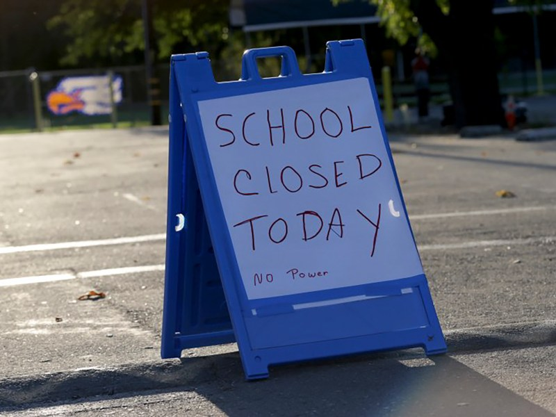 I sign informs parents and students Sunol Glen Elementary School is closed during a power outage in Sunol, Calif. on Oct. 10, 2019.
