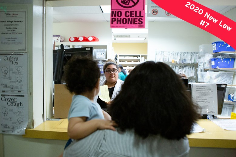Photo of family standing in line at pharmacy. Photo by Anne Wernikoff for CalMatters.