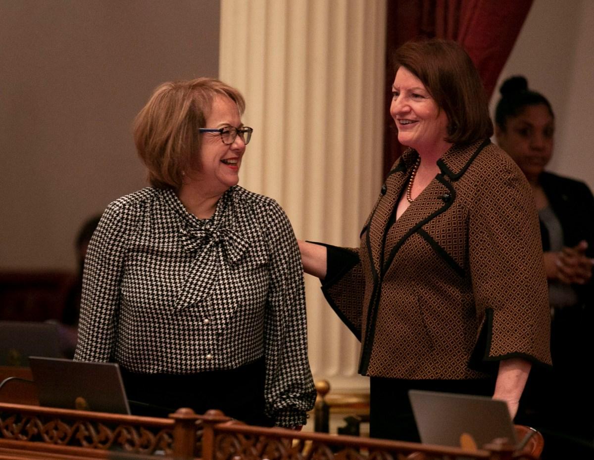 Sen. Maria Elena Durazo,, left, and Senate President pro Tempore Toni Atkins smile on the senate floor on the first day of the 2020 legislative session