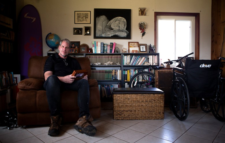 Portrait of foster parent Andrew Simmons in the family room of his Ramona, CA home. The wheelchair belongs to his daughter who suffers from juvenile rheumatoid arthritis