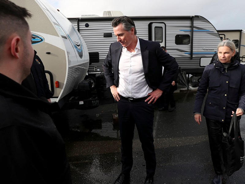 Gov. Gavin Newsom pauses by FEMA trailers after speaking at a press conference on homelessness during the final stop of his statewide tour to address the issue in Oakland, Calif., on Thursday, Jan. 16, 2020. The city will receive 15 unused FEMA trailers to use as temporary housing for homeless people. Photo by Jane Tyska/Bay Area News Group