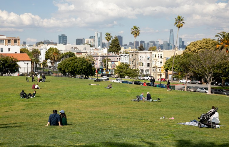 Park goers enjoy the sunshine while maintaining social distance a Dolores Park in San Francisco on March 20, 2020. On Thursday, Gov. Gavin Newsom ordered all of California to shelter in place and avoid leaving home except for essential needs. Photo by Anne Wernikoff for CalMatter