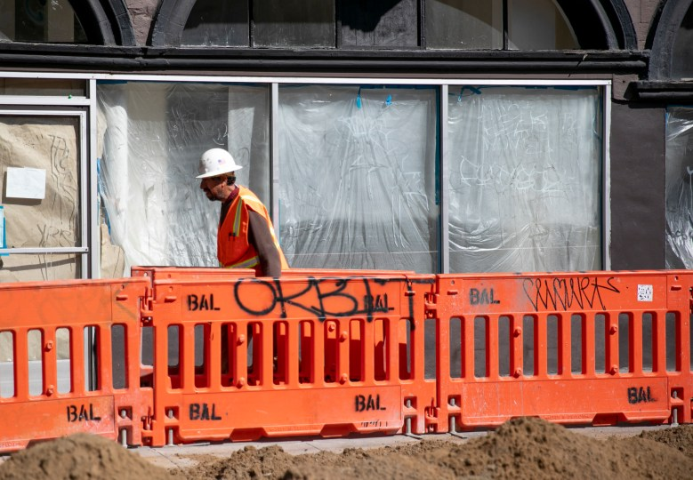 A construction worker in the Haight-Ashbury neighborhood of San Francisco on March 25, 2020. Public works employees are exempt during the shelter in place order. Photo by Anne Wernikoff for CalMatters