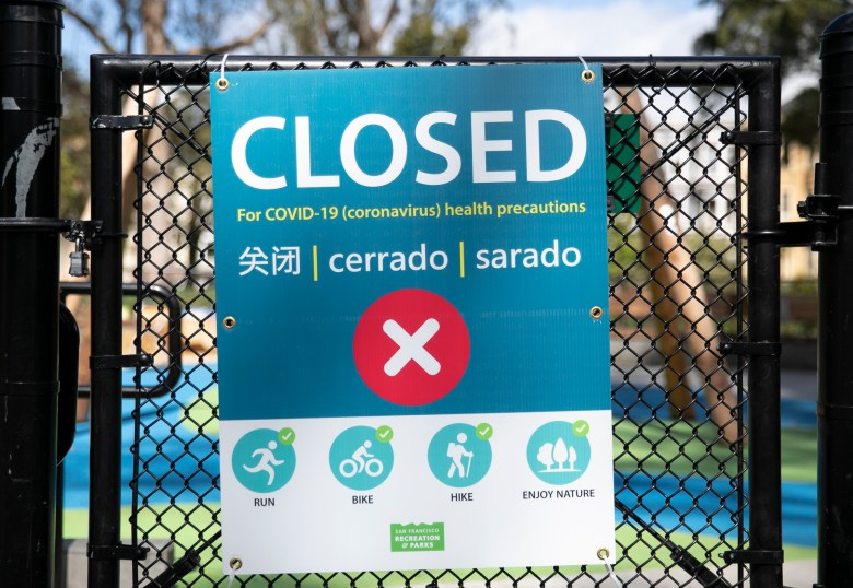 A locked playground gate in San Francisco. Following an influx of park-goers over the weekend, Gov. Gavin Newsom has closed parking lots at state parks across the state in an effort to limit to spread of COVID-19. Photo by Anne Wernikoff for CalMatters
