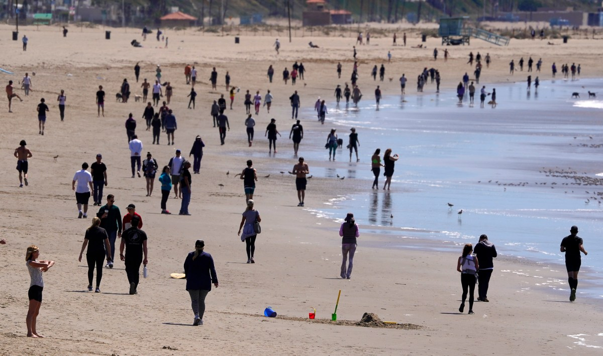 People crowd Venice Beach in Los Angeles on March 21, 2020, despite government orders to stay home to curb the spread of coronavirus. Photo by Mark J. Terrill, AP Photo