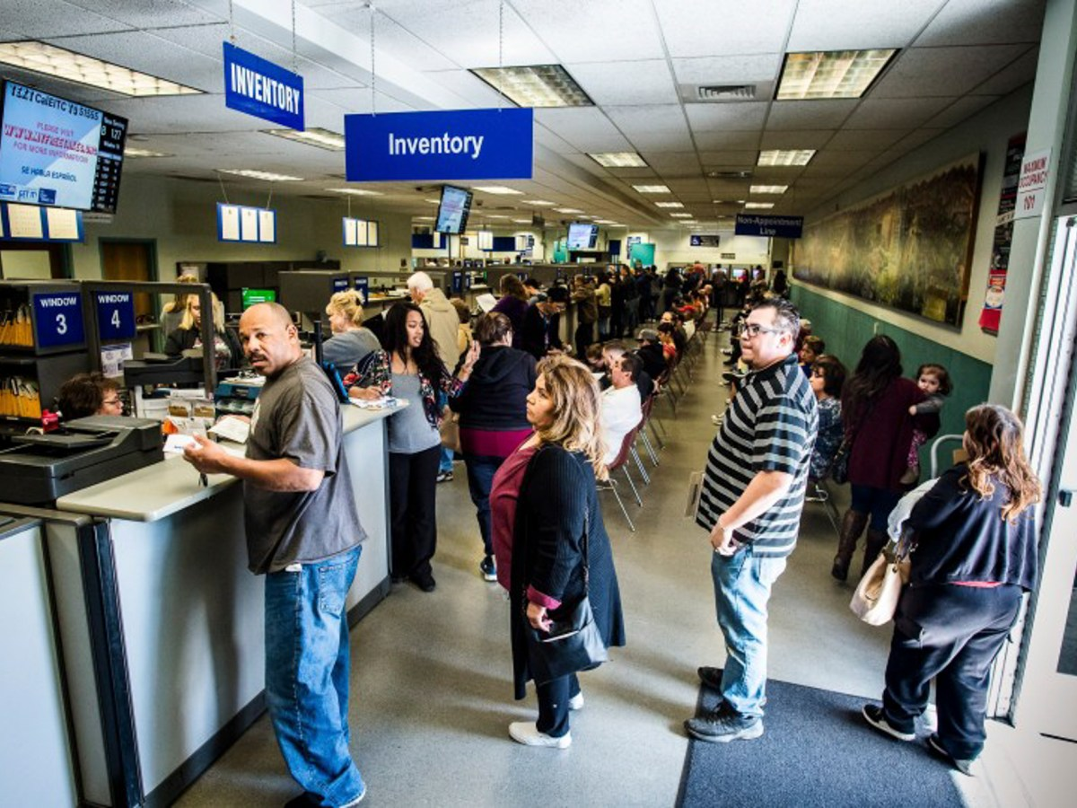 People wait in line to check in at the DMV in Riverside on Friday, March 8, 2019. Photo by Watchara Phomicinda, The Press-Enterprise/SCNG