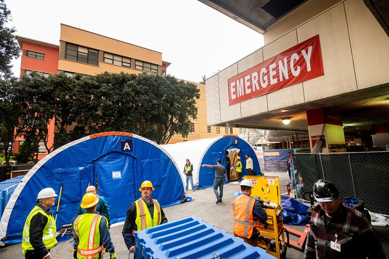 UCSF workers erect Accelerated Care Units (ACU) outside the Parnassus emergency room to provide a negative pressure environment to house patients with respiratory symptoms