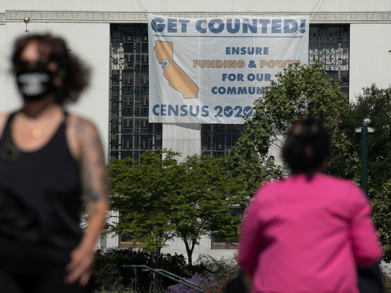 A sign encouraging residents to participate in the 2020 census hangs from the Alameda County Courthouse in Oakland on April 28, 2020. Photo by Anne Wernikoff for CalMatters