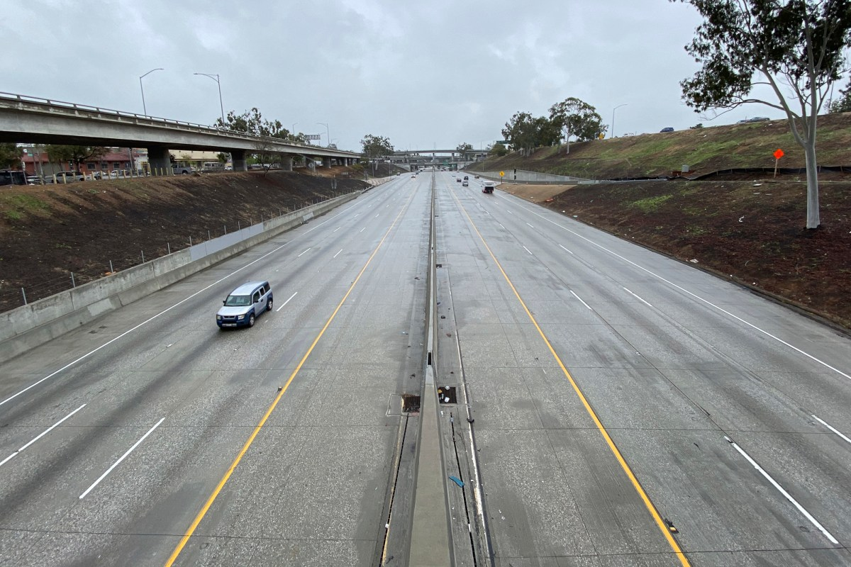 General overall view of sparse traffic on the Interstate 710 freeway amid the global coronavirus COVID-19 pandemic, Thursday, April 9, 2020, in Los Angeles. Photo by Kirby Lee via AP