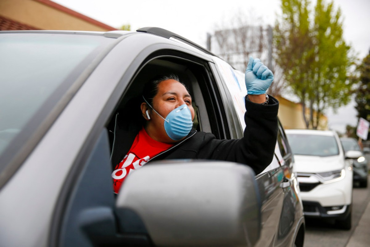 Guadelupe Sanchez, an employee at a McDonald's restaurant in San Leandro, led a caravan of fellow essential workers as they circled a Hayward location on April 9 to demanding wage increases and more personal protective equipment from the corporation as essential workers during the coronavirus pandemic. Photo by Dylan Bouscher, Bay Area News Group