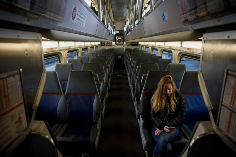 A lab assistant at Santa Clara University Megan Wright of San Jose sits in an empty Caltrain car waiting to depart from the Diridon train station during the morning rush hour in downtown San Jose, on March 17, 2020. Photo by Dai Sugano, Bay Area News Group