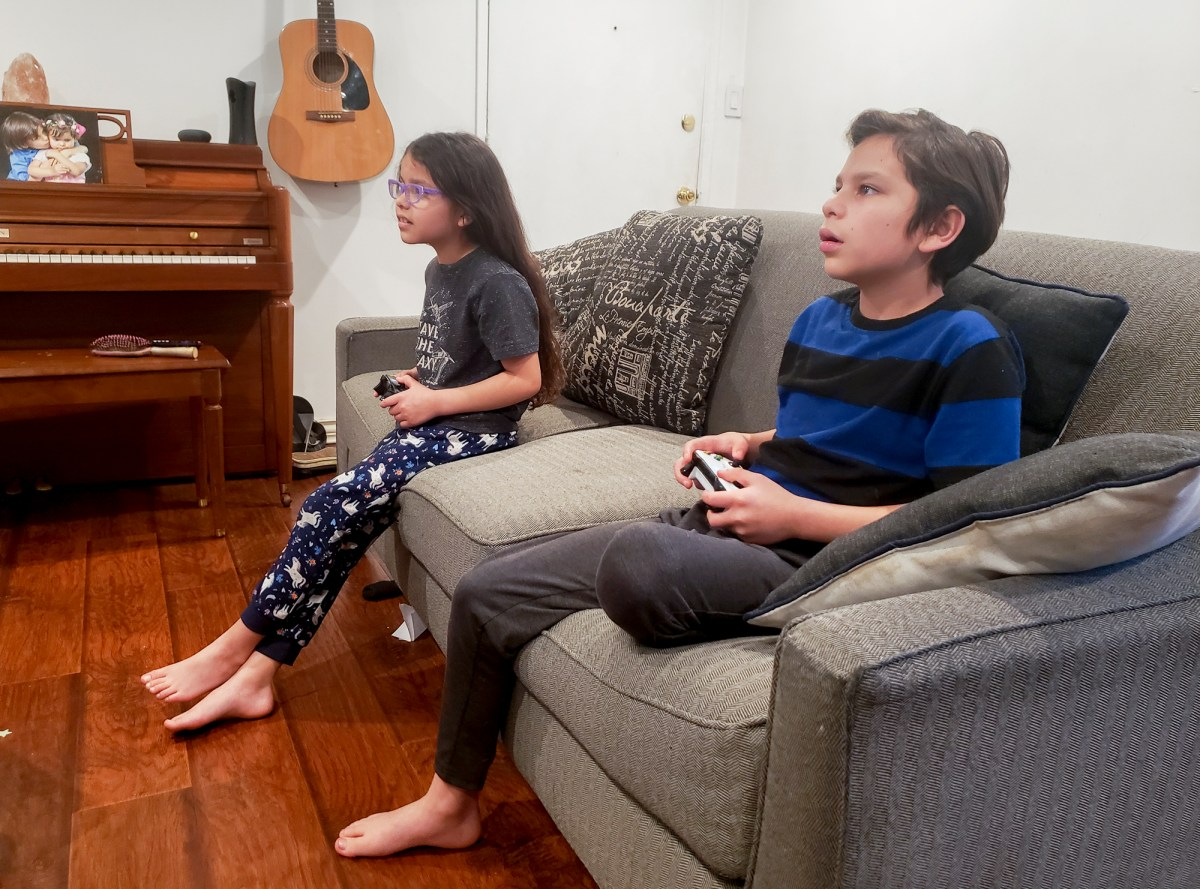 Melina, 8, and her brother Adrian, 9, play minecraft before bed. Photo courtesy of Raul Torres