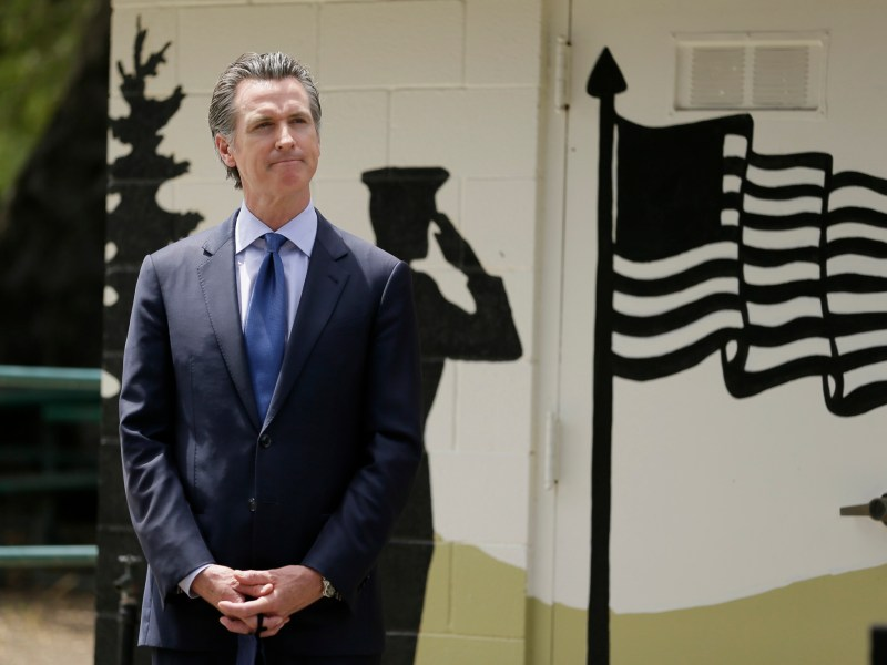 Gov. Gavin Newsom listens as CalVet Secretary Vito Imbasciani speaks during a news conference at the Veterans Home of California May 22, 2020, in Yountville. Photo by Eric Risberg, AP Photo/Pool