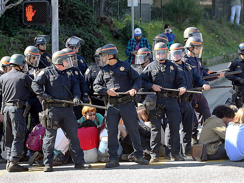 University of California police form a barrier around a group of students before they are arrested and carted away for blocking an intersection at the entrance to UC Santa Cruz on February 12, 2020. Photo by Dan Coyro, Santa Cruz Sentinel