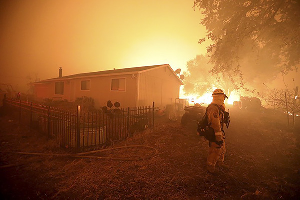 A Cal Fire firefighter watches over a structure as the Kincade Fire threatens along Chalk Hill Road in Healdsburg on Oct. 27, 2019. Photo by Anda Chu, Bay Area News Group