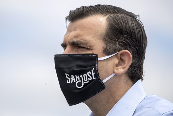Mayor Sam Liccardo wears a San Jose branded face mask while waiting to speak at a press conference at the COVID-19 testing site in the parking lot of PAL Stadium in San Jose on Wednesday, May 20, 2020. Photo by Karl Mondon, Bay Area News Group
