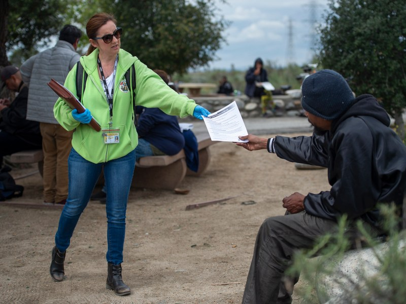 Elizabeth Cope, Mental Health Clinical Supervisor with the Home Outreach Team, conducts outreach and distributes information regarding COVID-19 during a resource fair at Lario Park, March 24, 2020. Photo by Los Angeles County via Flickr
