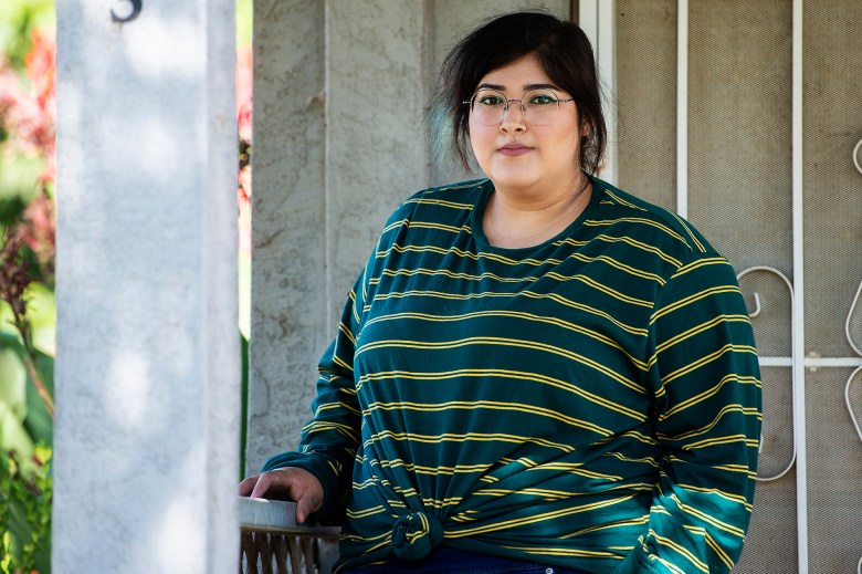 Nancy Valladolid, 24, poses for a portrait outside her home in Merced County on Wednesday, July 29, 2020. Photo by Andrew Kuhn, The Merced Sun-Star