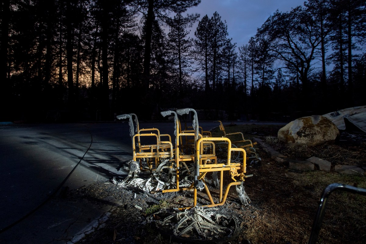 Scorched wheelchairs rest outside Cypress Meadows Post-Acute, a nursing home leveled by the Camp Fire in Paradise on Dec. 4, 2018. Photo by Noah Berger, AP Photo