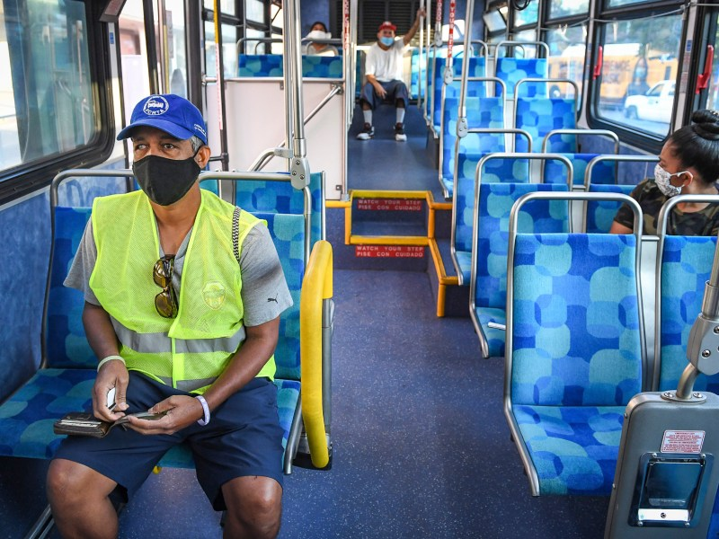 Yonas Paulos, who is visually impaired and relies on buses to get to his medical appointments, takes a seat on a Fresno Area Express bus in downtown Fresno on Aug. 28, 2020. He is concerned about catching the coronavirus while riding the bus or at a stop with too many people. Photo by Craig Kohlruss, The Fresno Bee
