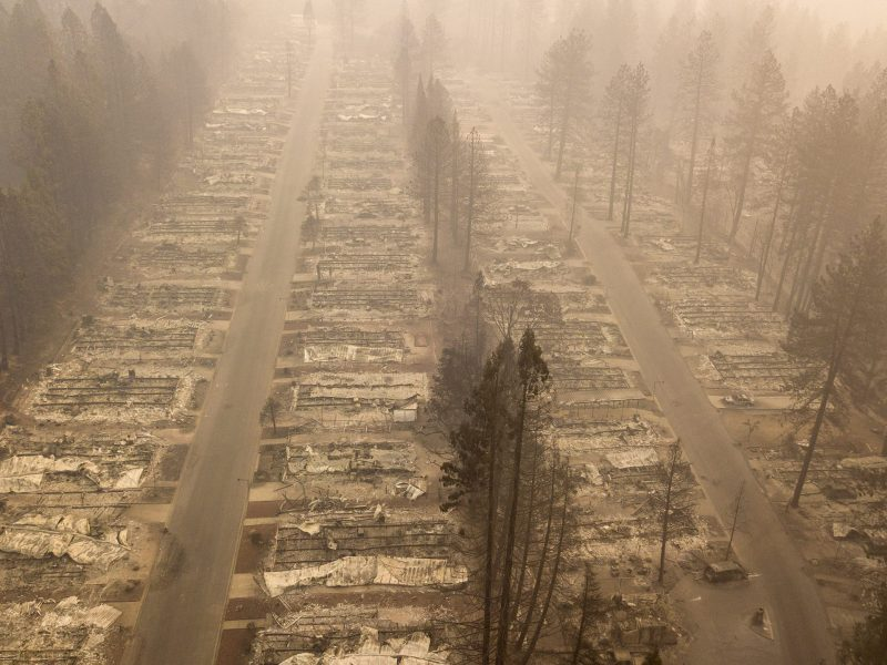 In this aerial photo, a burned neighborhood is seen in Paradise, California on November 15, 2018. - The toll in the deadliest wildfires in recent California history climbed to 59 on November 14, 2018, as authorities released a list of 130 people still missing. Photo by JOSH EDELSON, AFP via Getty Images