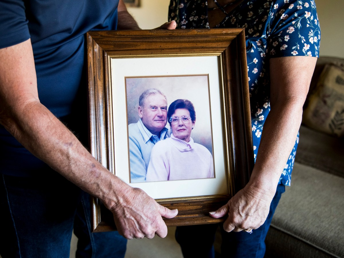 Mark and Kathy Allen hold a photo of Mark's parents at their home in Sebastopol on July 29, 2020. Mark and Kathy evacuated Mark's mother and several other residents of the Villa Capri retirement community as the Tubbs Fire approached in October of 2017. The Oakmont of Varenna nursing home and assisted living facility in Santa Rosa on July 29, 2020. Photo by Beth LaBerge, KQED