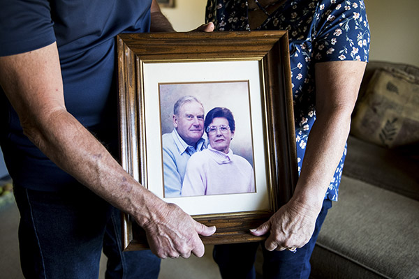 Mark and Kathy Allen hold a photo of Mark's parents at their home in Sebastopol on July 29, 2020. Mark and Kathy evacuated Mark's mother and several other residents of the Villa Capri retirement community as the Tubbs Fire approached in October of 2017. Photo by Beth LaBerge, KQED