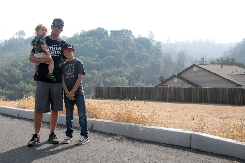 Kody Petrini with his sons, Levi, 16 months, and Steven, 11, in Berryessa Highlands on Sept. 21, 2020. Petrini lost his home in the LNU Lighting Complex Fires and for more than a month afterward was afraid to bathe Levi with tap water for fear of contaminants. Photo by Anne Wernikoff for CalMatters