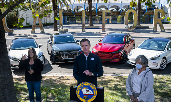 California Gov. Gavin Newsom speaks at a press conference on Sept. 23, 2020, at Cal Expo in Sacramento where he announced an executive order requiring the sale of all new passenger vehicles to be zero-emission by 2035. Photo by Daniel Kim, The Sacramento Bee via AP/Pool