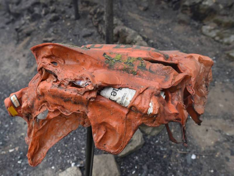 A melted newspaper box stands in a burned area of Meadow Lakes on Saturday Sept. 12, 2020. Photo by John Walker, The Fresno Bee