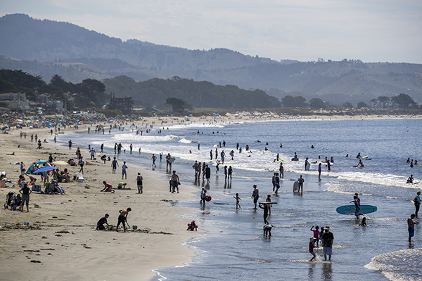 Visitors enjoy the beach in Half Moon Bay on Aug. 15, 2020. Californians are bracing for another heatwave over the holiday weekend. Photo by Anda Chu, Bay Area News Group