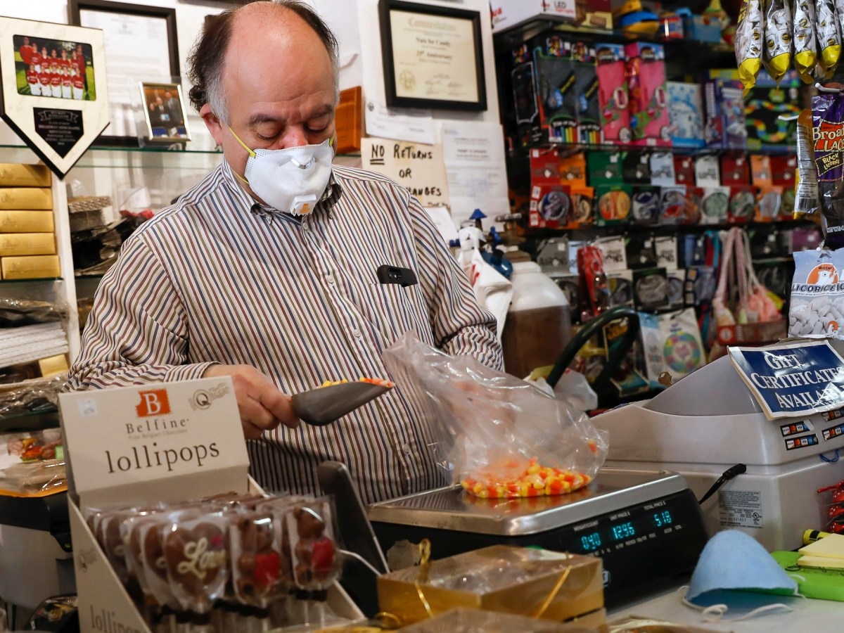Owner John Kevranian fills a bag up with candy corn at Nuts for Candy & Toys in Burlingame on May 18. He is among small business owners worried that the cost of property tax hikes inherent in Prop. 15 will get passed on to small businesses. Photo by Randy Vazquez, Bay Area News Group