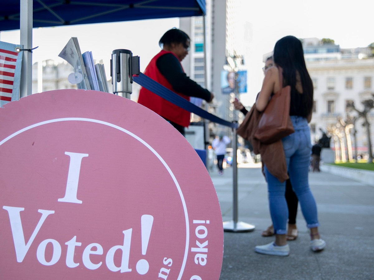 Voters drop off their ballots at the outdoor polling station at San Francisco City Hall on Super Tuesday 2020. Photo by Anne Wernikoff for CalMatters